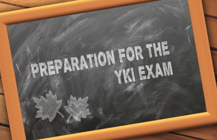 """Blackboard with a chalked on message """"Preparation for the YKI exam""""."""